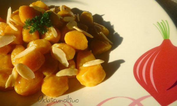 Gnocchi eco di ricotta, bucce di carote e mandorle