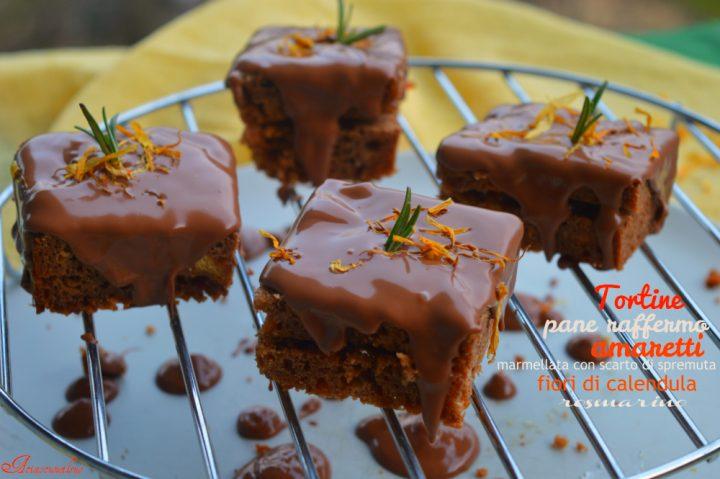 Tortine di pane raffermo e amaretti farcite di marmellata di scarto di spremuta e ricoperte di cioccolato