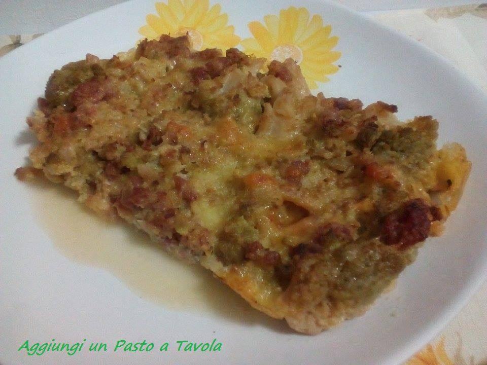 Broccoli romaneschi con salsiccia e mozzarella al forno
