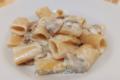 Mezze maniche con crema di parmigiano reggiano e funghi