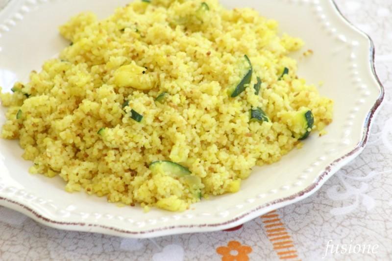 cous cous con pesce persico zucchine e curcuma