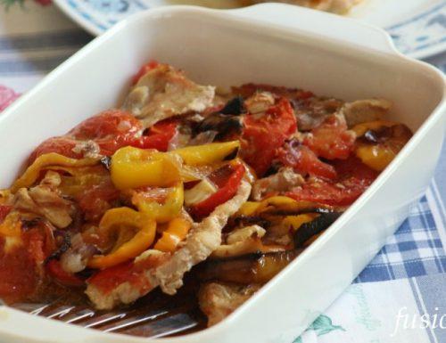 fettine di carne con peperoni pomodori e cipolle
