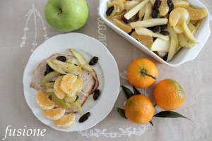arrosto di maiale con mele clementine e uva
