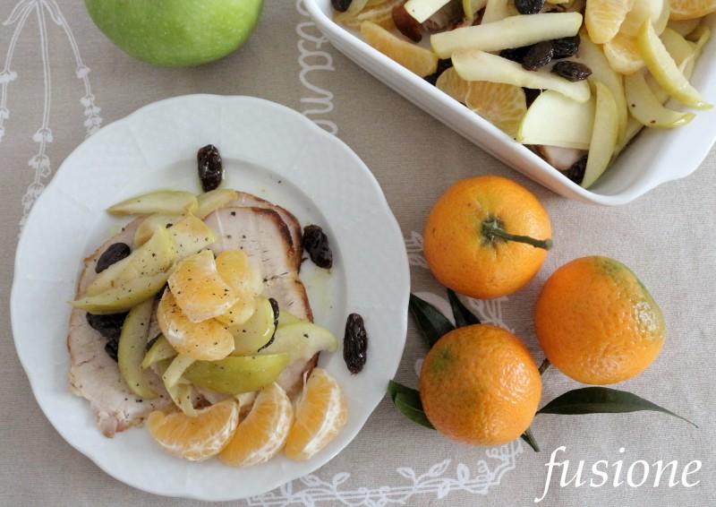arrosto di maiale con mele clementine e uva essiccata