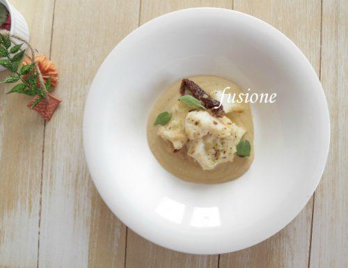 baccalà con pomodori secchi su crema di fagioli