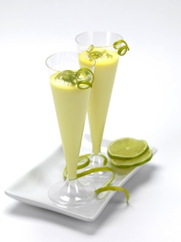 a lemon flavored mousse in a flute glass with lemon serpantines