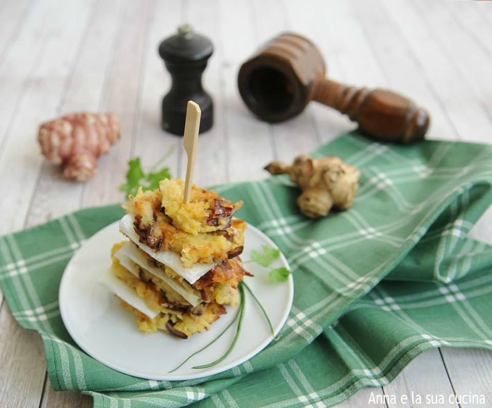 Schiacciatine di topinambur con olive e pomodori secchi