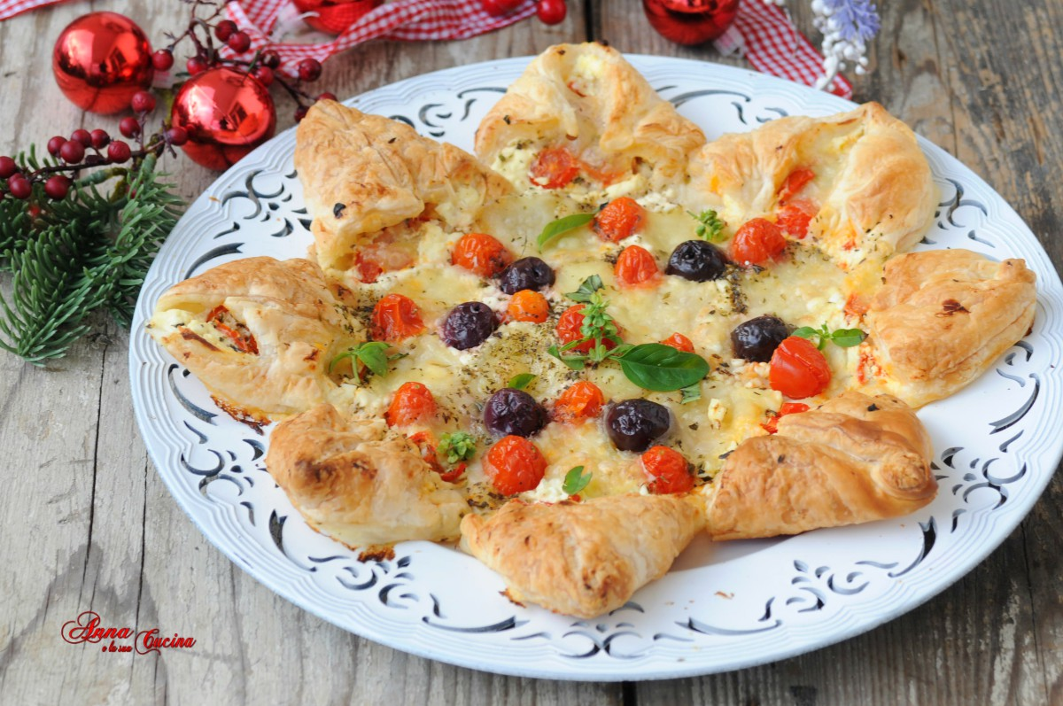 Stella di pasta sfoglia salata con pomodorini e olive