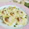 Margherite di patate in rosa, con gorgonzola e basilico