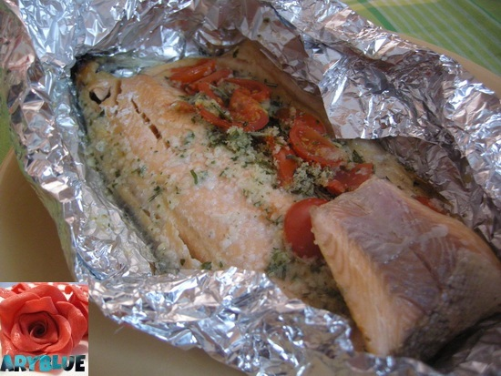 Filetti di trota salmonata al cartoccio con pomodorini for Cucinare trota