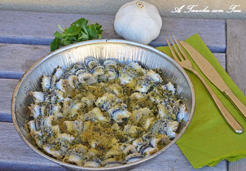 Acciughe al forno aglio e prezzemolo
