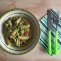 pasta con fiori di zucchina, speck e brie