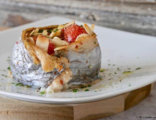 Girelle di pesce spatola con pomodorini e capperi
