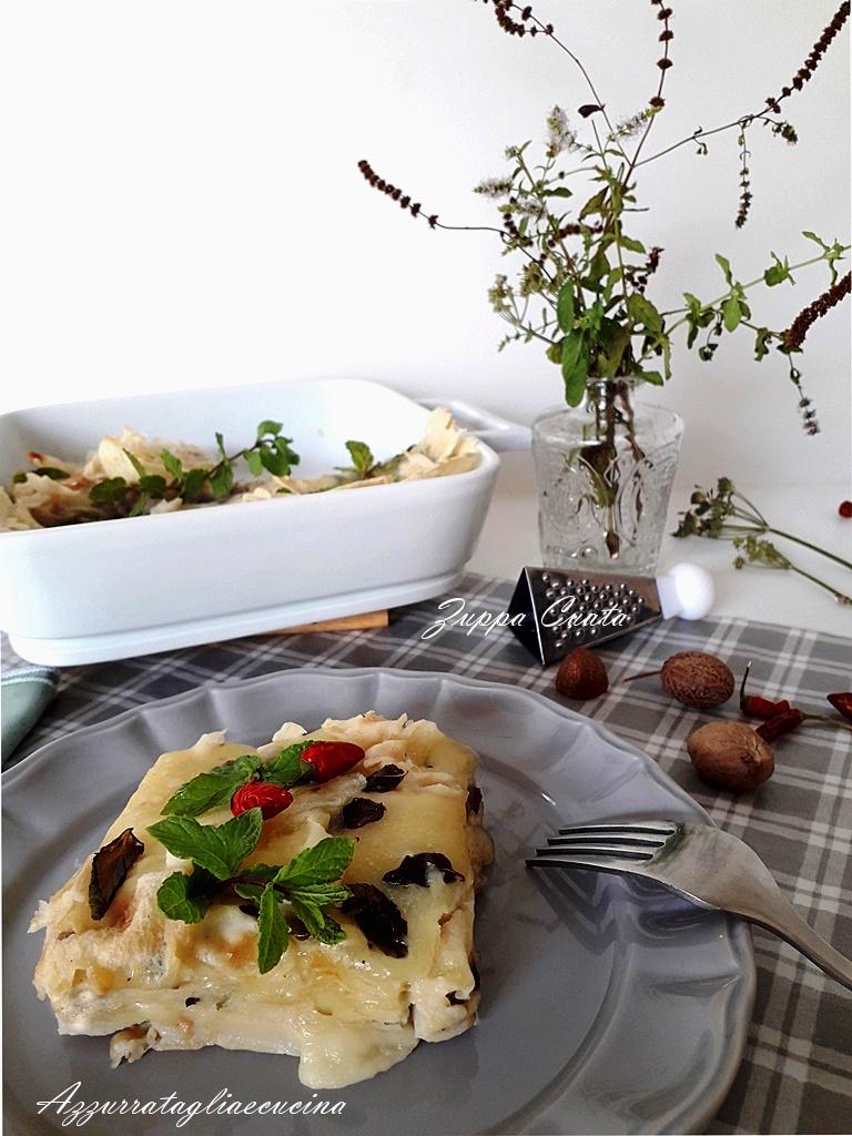 Zuppa Cuata su piatto grigio e terrina bianca sullo sfondo