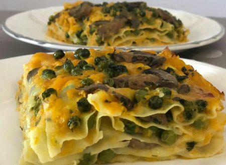 Lasagne con crema di zucca, funghi, piselli e parmigiano reggiano