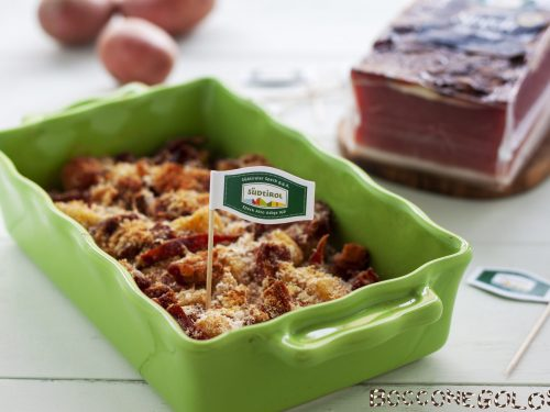 Patate sabbiose e speck – contorno croccante al forno.