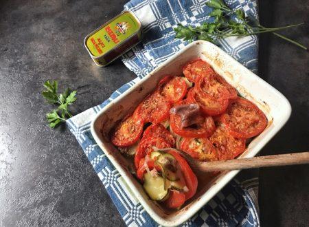Gratin di pomodori zucchine e alici