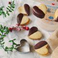 Biscotti di pasta frolla all'olio agli agrumi con marmellata di arance e glassa all'acqua al cioccolato
