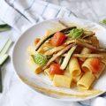 Mezze maniche con pomodorini alici zucchine fritta e ricotta salata