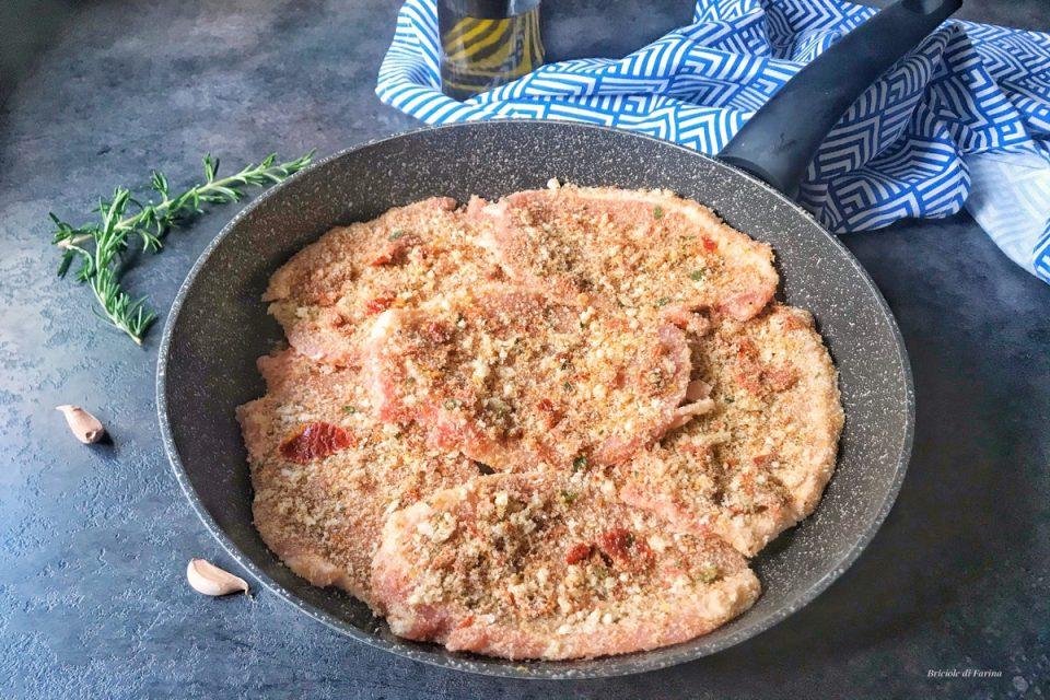 Fettine di maiale in crosta aromatica con erbe E scorza di limone