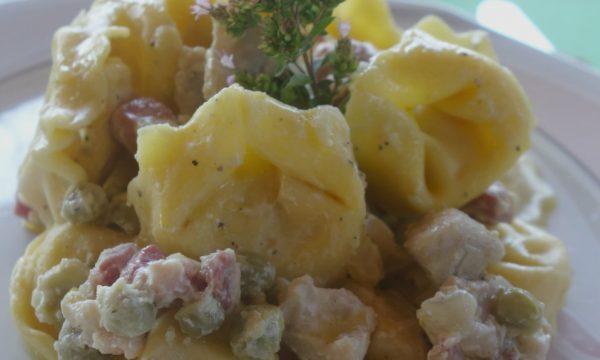Tortellini al ragù di coniglio e bacon in bianco