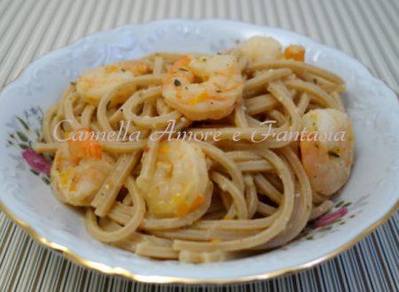 Spaghetti integrali con pesto di agrumi zenzero e scampi