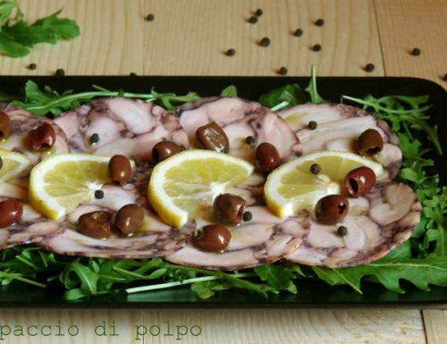 Carpaccio di polpo su letto di rucola con olive nere