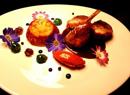 Cosciotto e sella di coniglio nella sua salsa con flan di cavolfiore, quenelle di carote, purè di piselli e salsa al moscato di pantelleria