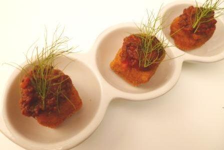 Finger food prezioso: cubi di carnaroli con salsa di escargots….