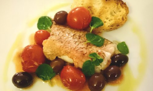 Scorfano al cartoccio con pomodorini, mentuccia ed olive Itrana