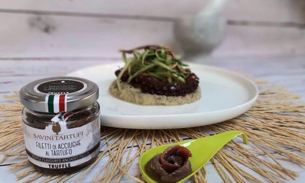 Polpo rosticciato con puntarelle alla salsa di acciughe al tartufo su purea di topinambur