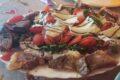 Tagliata di manzo con fonduta di taleggio, pomodorini e rucola.