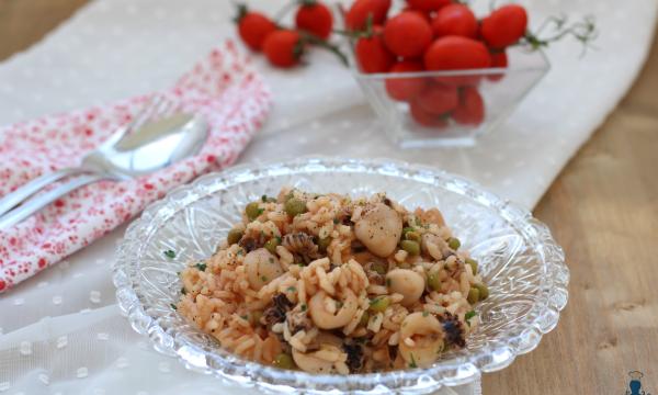 Risotto con moscardini e piselli in umido, ricetta di mare