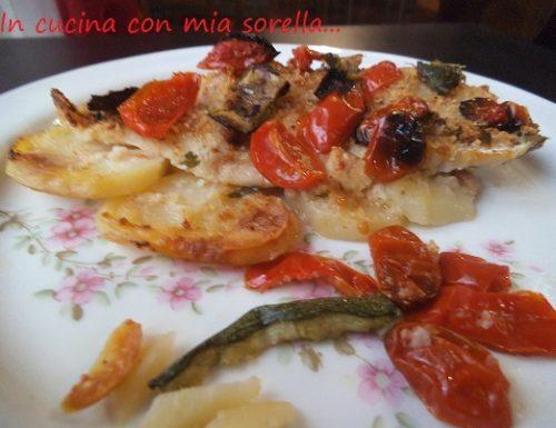 Cernia su letto di patate con pomodorini e zucchine Ricetta Secondo Pesce