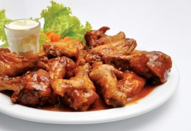 Cosce ali pollo salsa chili rossa sapore forte deciso