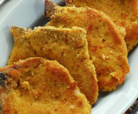 Braciole maiale profumate alle spezie impanate al forno