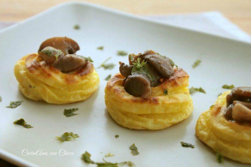 Nidi di patate con funghi