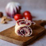 Rotolini di salmone con noci, radicchio e pomodorini