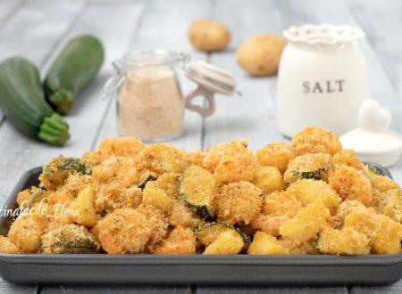 Gamberi con patate e zucchine al forno