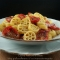 Pasta con pomodorini confit e cipolle Tropea