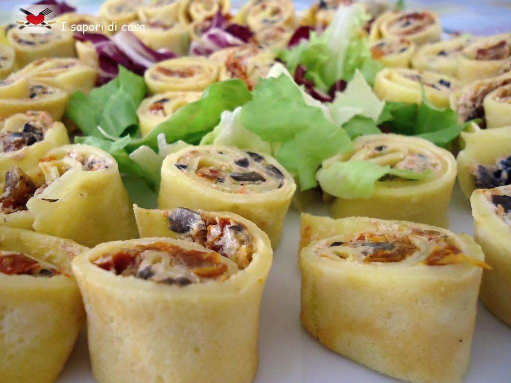Rotolini di crepes con crema ai pomodori secchi