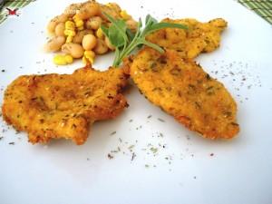 Cotolette di pollo con panatura al parmigiano ed erbette