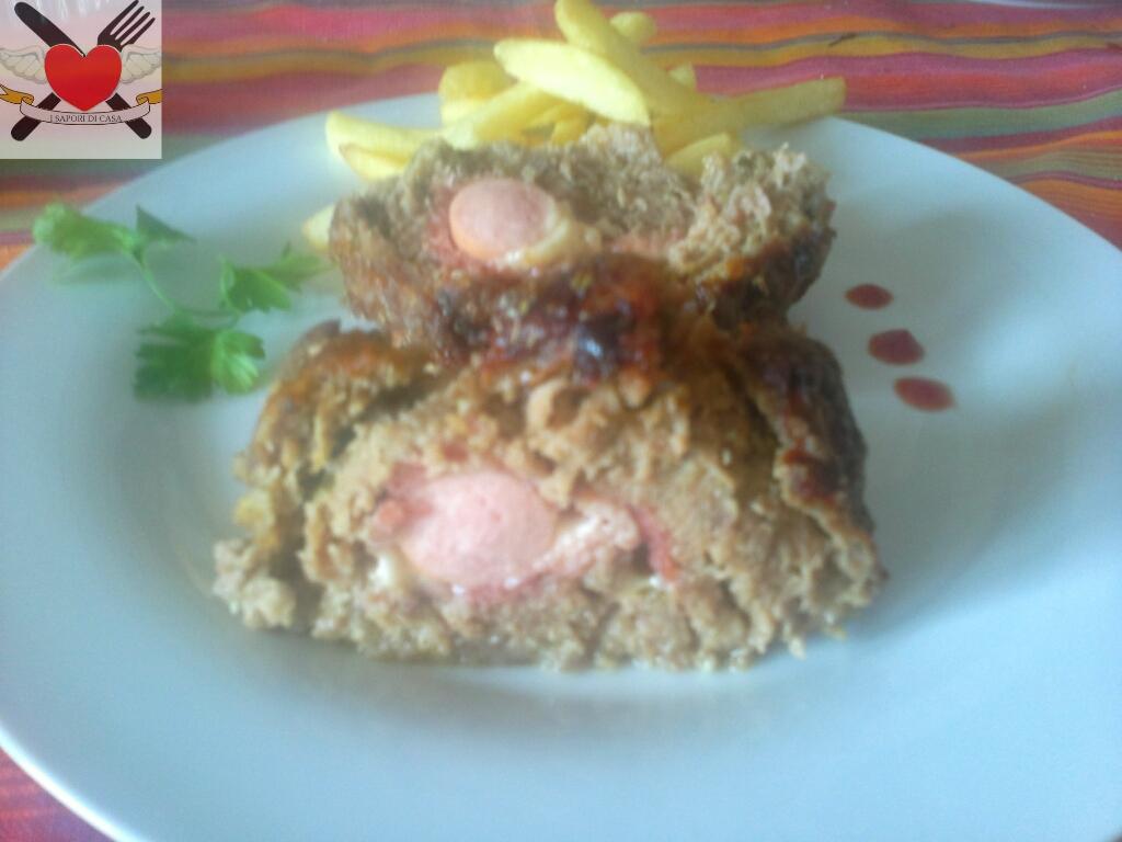 Polpettone di carne ripieno con prosciutto cotto wurstel e grana