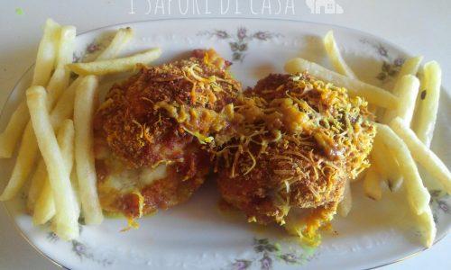Sovracosce di pollo ripiene con prosciutto e formaggio
