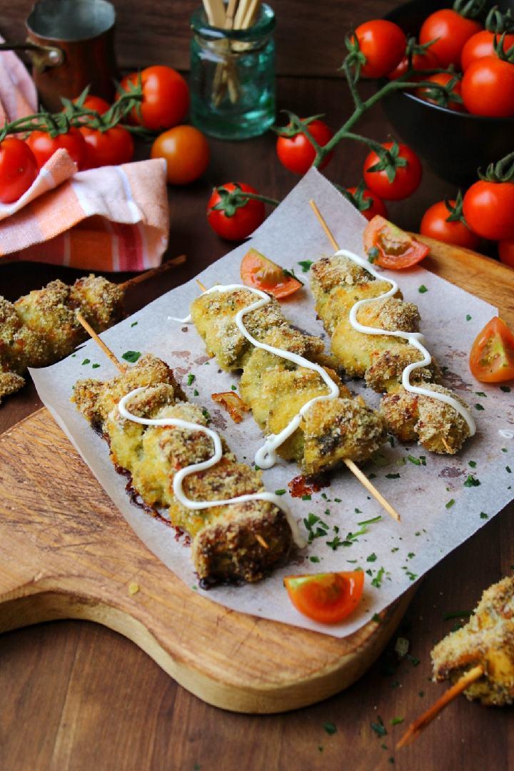 Spiedini di pollo gratinati al forno