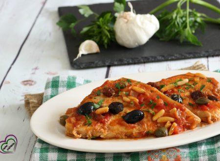 Pesce spada con olive, pinoli e uvetta alla siciliana
