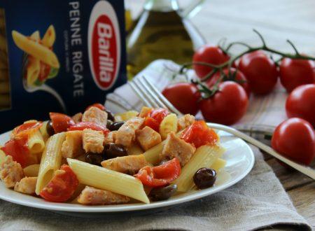 Penne con pesce spada, pomodorini e olive