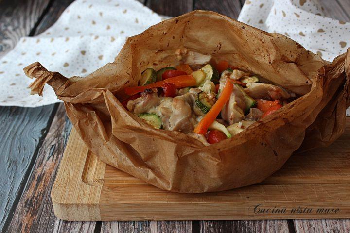 Pollo al cartoccio con verdure Cucina vista mare