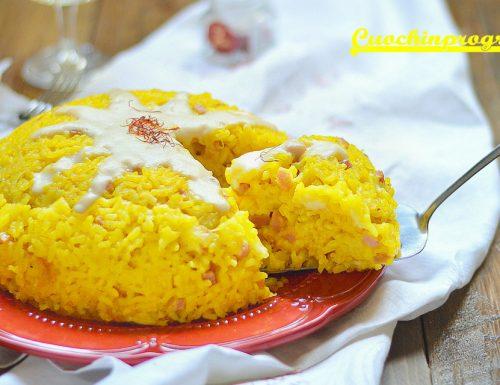 Timballo di riso giallo con formaggi e prosciutto
