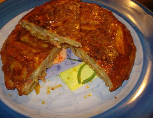 frittata di pasta con pomodori carciofi e speck.